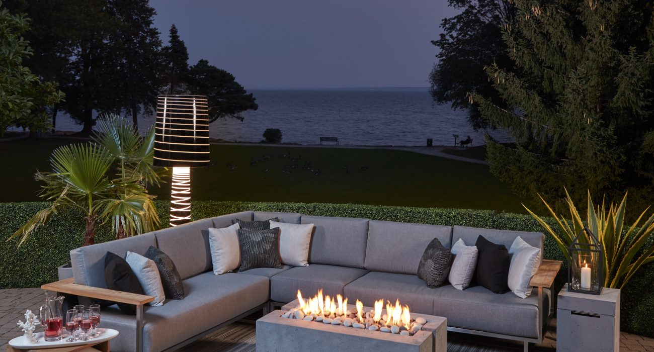 X8 Collection and DEKKO Avera Fire Pit at Night