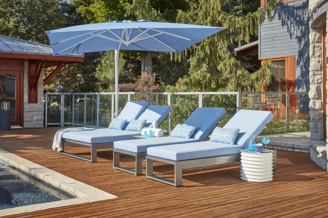 Nevis Double Chaise Lounge and Chaise Lounges in Pewter with a Cantilever Umbrella