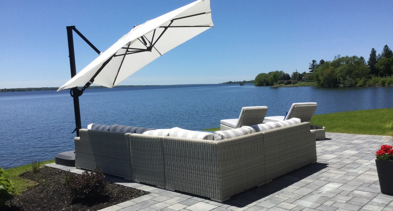 Vineyard Sectional with Chaise Lounges and a Cantilever Umbrella