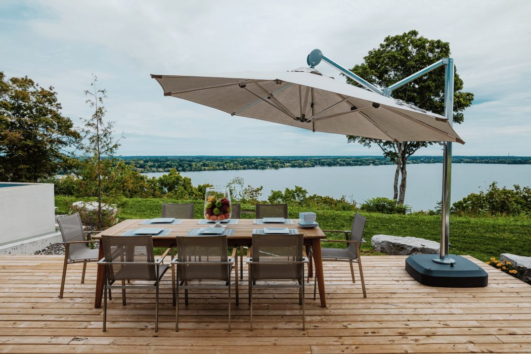 Alzette Dining Arm Chairs with a Cantilever Umbrella
