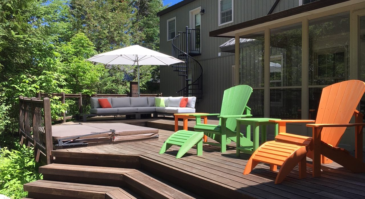 Streamline Sectional with a Cantilever Umbrella and Muskoka Chairs