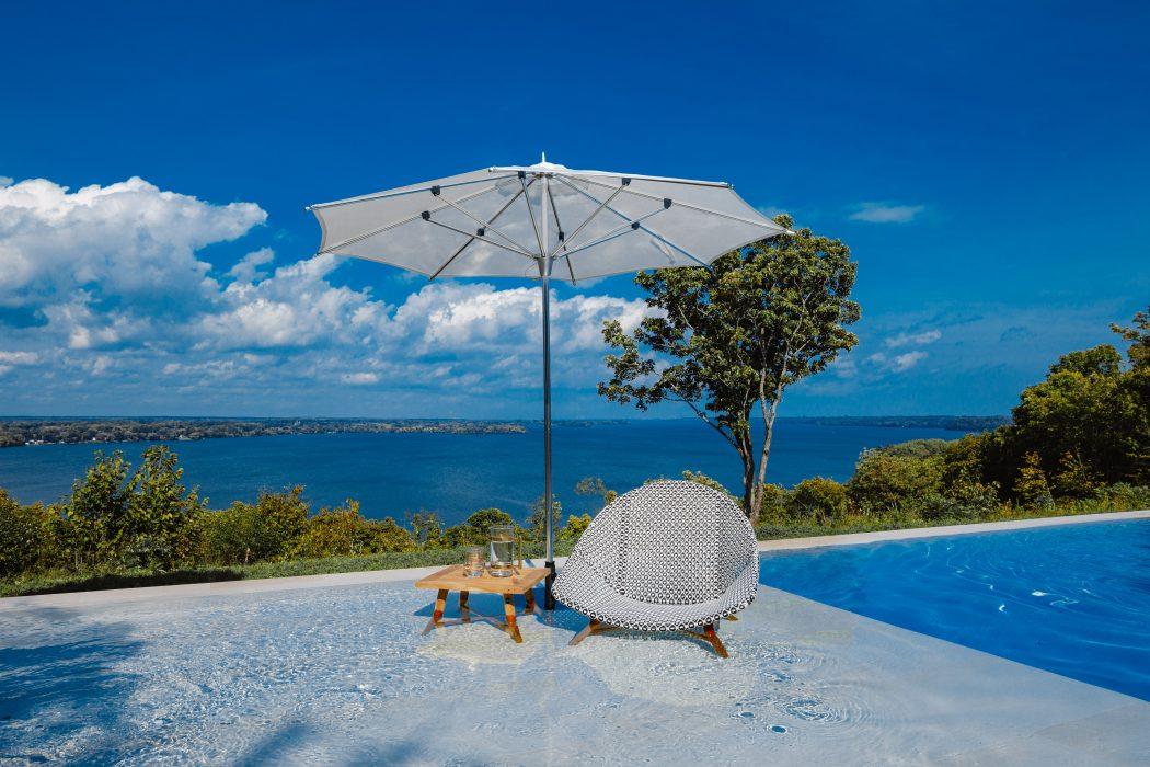Breeze Club Chair with a Market Umbrella